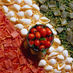 Bowl of Tomatoes on Tricolored Pasta